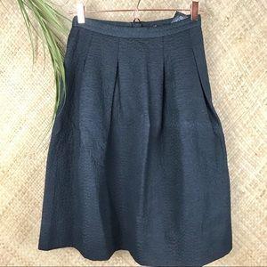 A line pleated textured knee length skirt